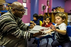 Librarian Colbert Nembhard with Homeless Children of Shelters, Photo Courtesy of the New York Times